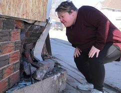 Gaelyn Coleman surveys damage to her business, Amore For Your Pleasure, on Saturday.