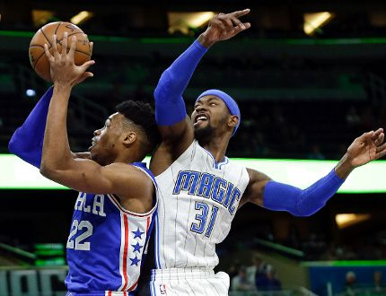 Orlando Magic's Terrence Ross (31) tries to stop Philadelphia 76ers' Richaun Holmes (22) from going to the basket Monday, March 20, 2017, in Orlando, Fla. (AP Photo/John Raoux)