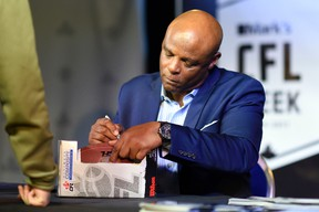 Football legend Warren Moon signs autographs during CFL Week in Regina. (TROY FLEECE/Postmedia Network)