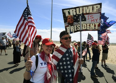 "Supporters of US President Trump march during the ""Make America Great Again"" rally in Huntington Beach, California on March 25, 2017.  / AFP PHOTO / Mark RALSTONMARK RALSTON/AFP/Getty Images"
