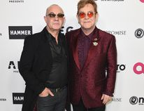 Elton John, right, and Bernie Taupin arrive at Elton John's 70th Birthday and 50-Year Songwriting Partnership with Taupin on Saturday, March 25, 2017 in Los Angeles. (Photo by Jordan Strauss/Invision/AP)