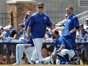 Blue Jays manager John Gibbons shares a laugh with some of his players before the start of a spring training game against the Tigers in Dunedin, Fla., on March 22, 2017. (Chris O'Meara/AP Photo)