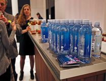 In this March 8, 2017 photo, bottles of water and flavored tea are displayed during The Shine, an alcohol-free social social event at a chic hotel in the Williamsburg neighborhood in the Brooklyn borough of New York. These events, which are popping up in New York, Los Angeles and Chicago, are part of a trend fueled by millennials seeking to find meaningful connections while they party, (AP Photo/Kathy Willens)
