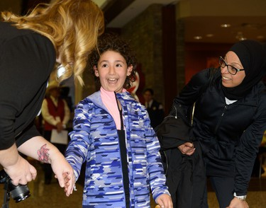 Director of Children's Wish Kyla Martin gives Lilyana El-Hajjar, 9, the news that her wish to go to Walt Disney World is being granted in Calgary on Tuesday, March 28, 2017. Lilyana was diagnosed with Acute Lymphoblastic Leukemia at the age of six. After invasive treatments she is now in remission and on course to make a full recovery. Pier Moreno Silvestri/Postmedia Network