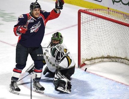 Windsor Spitfires Cristiano DiGiacinto celebrates after the puck scores on London Knights goaltender Tyler Parsons during first period Ontario Hockey League playoff action at the WFCU Centre in Windsor, Ontario on March 28, 2017. The goal was scored by Windsor Spitfires Julius Nattinen. (JASON KRYK/Windsor Star)
