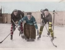 Cam Tait's dad, Harold, in goal, plays hockey with George Ness, left, and Keith Allen. Tait's son Darren is seen at right. Photos supplied.