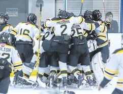 Tim Gordanier/The Whig-Standard The Greater Kingston Jr. Frontenacs celebrate their thrilling 4-3 comeback victory over the North Central Predators in the deciding game of their Eastern Triple-A Hockey League bantam division championship series on Tuesday night at the Invista Centre. The Fronts fell behind 3-2 about five minutes into the third period but scored twice in the last seven minutes, including a goal by Luc Reeve with just 43.8 seconds left on the clock, to win. The Fronts won the seesaw six-point series, 7-5.
