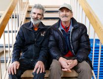 Luke Hendry/The Intelligencer Brothers Bill, left, and Mike Horsburgh sit in the stairwell of the Salvation Army building Tuesday in Belleville. Separated for years, they searched for each other and reunited after Mike read an Intelligencer story which mentioned Bill's volunteer role with the Army.