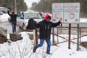 An asylum claimant crosses the border into Canada from the United States, Tuesday, March 28, 2017 near Hemmingford, Que. (THE CANADIAN PRESS/Paul Chiasson)
