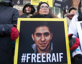 Saudi Arabia has again delayed a planned flogging of a blogger, according to a report from Amnesty International. Ensaf Haidar, wife of blogger Raif Badawi, takes part in a rally for his freedom, Tuesday, January 13, 2015 in Montreal. (THE CANADIAN PRESS/Ryan Remiorz)