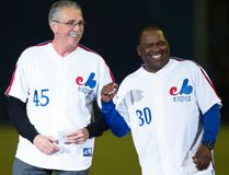 Former Montreal Expos players Steve Rogers (left) and Tim Raines share a laugh during a ceremony prior to a pre-season game in Montreal between the Toronto Blue Jays and the New York Mets on March 28, 2014. (Paul Chiasson/The Canadian Press/Files)