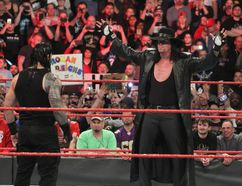 The Undertaker stares down his WrestleMania 33 opponent Roman Reigns during a recent episode of Raw. Sunday's match will be The Undertaker's 25th at WrestleMania. (George Tahinos/SLAM! Wrestling)