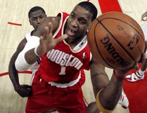 In this Dec. 12, 2007, file photo, Houston Rockets' Tracy McGrady goes up for a shot in Houston. (AP Photo/David J. Phillip, File)