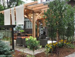 Pergolas with large fabric panels that can be installed every spring are a great way to reduce the amount of sunlight and heat that a patio absorbs. Postmedia Network