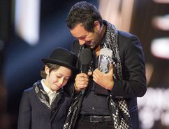 Adam Cohen and his son Cassius accept, the award on behalf of his father Leonard Cohen, for Album of the Year at the Juno awards show Sunday April 2, 2017 in Ottawa.