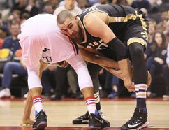 Toronto Raptors centre Jonas Valanciunas (17) battles for a loose ball against the Sixers Sunday at the ACC. (Veronica Henri/Toronto Sun/Postmedia Network)