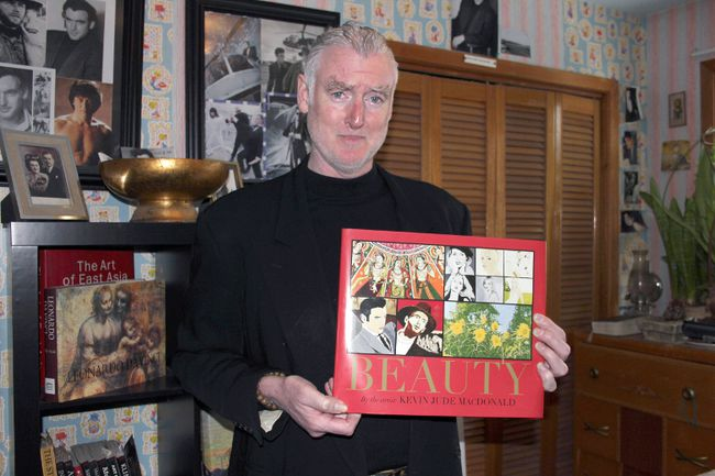 <p>Local artist Kevin Jude MacDonald with his newly published book on Tuesday March 28, 2017 in Cornwall, Ont. The coffee table book is a collection of his own paintings.</p><p> Lois Ann Baker/Cornwall Standard-Freeholder/Postmedia Network