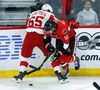 Senators' Clarke MacArthur checks Detroit Red Wings defenceman Danny DeKeyser on Tuesday at the Canadian Tire Centre. (The Canadian Press)