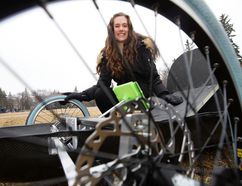 Natasha Pye, second year University of Alberta engineering physics student and assistant project manager for the Eco Car Team, poses with a new zero-emissions vehicle that engineering students designed and built. David Bloom, Postmedia Network