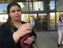 Sarah Hamza holds up a photo of her brother Raad Hamza outside the Edmonton Law Courts on April 4, 2017. Kyle Ashton was convicted of manslaughter in connection to Raad Hamza's death.