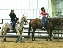 Zenna Wright of Teepee Creek was one of several riders attending a barrel racing clinic with Melissa Duff instructing March 31-April 2. She is shown getting some coaching from Duff on riding and barrel racing skills.