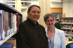 Wilson Bearhead, left, stands with Linda Garvin, executive director of customer experience with the Edmonton Public Library (EPL), at the Stanley A. Milner Library's temporary location at 10212 Jasper Avenue in Edmonton on Monday, April 3, 2017. Bearhead will be named the EPL's first Elder in Residence at a special ceremony on Friday, April 7, 2017. CLAIRE THEOBALD Postmedia