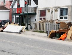 File photo shows typical roadside trash piles awaiting pickup during the annual spring clean-up event in Timmins. City council has agreed to keep the annual clean-up despite a suggestion during budget meetings that the city that the city could save money by ending the service. LEN GILLIS / THE DAILY PRESS / POSTMEDIA NETWORK