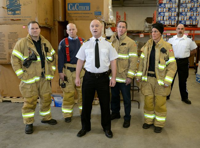 Firefighters Scott Young, Capt. Gary Martin, deputy Chief Dave Lazenby, Paul Schlinderer, Tina Sirka and St John Ambulance operations manager Jeff Lavigne take part in Friday's launch of the London Food Bank's 30th Spring Food Drive. (MORRIS LAMONT, The London Free Press)