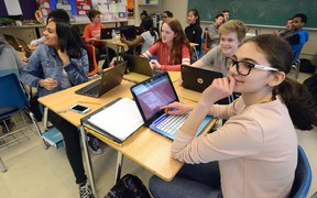 Tsion Samison, 14, Rhen Boyle, 15, Cole Hill, 14, and Noor Elsadi, l-r, use Chromebooks in their Grade 9 french class at Central Secondary School on Monday April 3, 2017. MORRIS LAMONT/THE LONDON FREE PRESS /POSTMEDIA NETWORK