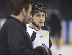 Knights over-ager Owen MacDonald talks with assistant coach Dylan Hunter about face-off techniques during a practice at Budweiser Gardens in London, Ont. on Monday April 10, 2017. Mike Hensen/The London Free Press/Postmedia Networ