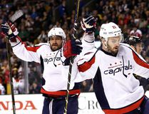 Kevin Shattenkirk of the Washington Capitals celebrates with Alex Ovechkin after scoring against the Boston Bruins at TD Garden on April 8, 2017 in Boston. (Maddie Meyer/Getty Images)