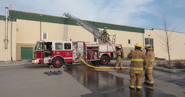 KEVIN RUSHWORTH HIGH RIVER TIMES/POSTMEDIA NETWORK. A fire broke out on the roof of the Bob Snodgrass Recreation Complex Monday evening, but is now under control thanks to the hard work of local fire crews.