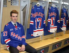 Chatham-Kent Cyclones defenceman Grayson Ladd of Kent Bridge visits the Kitchener Rangers' dressing room after being picked in the first round, 13th overall, in the Ontario Hockey League draft Saturday. (Photo courtesy of Kitchener Rangers Hockey Club)