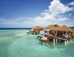 The overwater villas and bungalows at Sandals Royal Caribbean are perched over a quiet bay, with lovely Caribbean water and views that go on for miles. PHOTO COURTESY SANDALS RESORTS