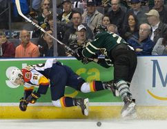 London Knights forward Adrian Carbonara wipes out Erie Otters forward Patrick Fellows during the first period of Game 3 of their OHL Western Conference semifinal at Budweiser Gardens on Tuesday night. The Otters won 3-1 to go up 2-1 in the best-of-seven series. (MORRIS LAMONT/THE LONDON FREE PRESS)