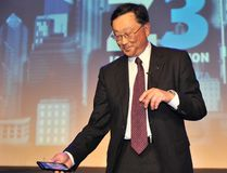 John Chen, right, Chief Executive Officer BlackBerry, holds the newly launched BlackBerry Z3 smartphone 'Jakarta edition' during a ceremony in Jakarta on May 13, 2014. (ADEK BERRY/AFP/Getty Images)