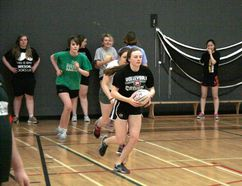 Banff Community High School senior girls fly half/kicker Amy Morton carries the ball through a drill during a rugby practice at the BCHS gymnasium on March 30. (Russ Ullyot/ Crag & Canyon/ Postmedia)
