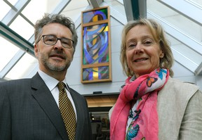 Scott Watson (left) and sister Catherine Watson (right) donated a stain glass window (background) to the Grey Nuns Hospital in southeast Edmonton, where it was unveiled in the front foyer of the hospital on Wednesday April 12, 2017.  (PHOTO BY LARRY WONG/POSTMEDIA)
