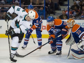 Edmonton Oilers forward Mark Letestu and goalie Cam Talbot watch Patrick Marleau of the San Jose Sharks in front of the net at Rexall Place in Edmonton on March 8, 2016. (Shaughn Butts)