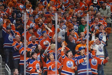 Edmonton fans cheer during a Stanley Cup playoffs game between the Edmonton Oilers and the San Jose Sharks at Rogers Place in Edmonton on Wednesday, April 12, 2017. Ian Kucerak / Postmedia