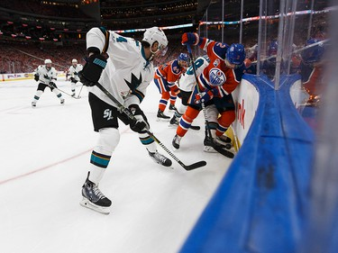 Edmonton's Andrej Sekera (2) battles San Jose's Brenden Dillon (4) during the third period of a Stanley Cup playoffs game between the Edmonton Oilers and the San Jose Sharks at Rogers Place in Edmonton on Wednesday, April 12, 2017. Ian Kucerak / Postmedia