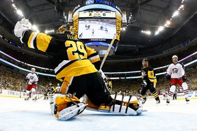 Marc-Andre Fleury #29 of the Pittsburgh Penguins makes a first-period save while playing the Columbus Blue Jackets in Game One of the Eastern Conference First Round during the 2017 NHL Stanley Cup Playoffs at PPG Paints Arena on April 12, 2017 in Pittsburgh, Pennsylvania. Pittsburgh won the game 3-1 to take a 1-0 series lead. (Gregory Shamus/Getty Images)