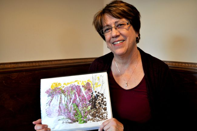 Trish Capitano-Andrew holds watercolour art done by her mom, Kay Capitano, who suffers from Alzheimer's disease, on March 30, 2017. The art will be displayed in a gallery at The ARTS Project April 18-22 dedicated to people and families affected by Alzheimer's. CHRIS MONTANINI\LONDONER\POSTMEDIA NETWORK