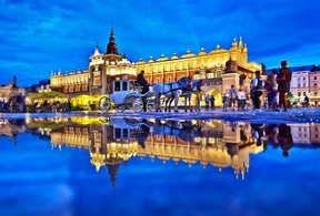 A rain puddle reflects the floodlit charm of Cloth Hall, one of several noteworthy buildings on Krakow's Main Market Square. DOMINIC ARIZONA BONUCCELLI PHOTO