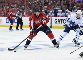 Washington Capitals right winger Justin Williams skates with the puck while pressured by Toronto Maple Leafs centre Auston Matthews during an NHL playoff game on April 13, 2017. The (AP Photo/Molly Riley)