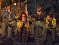 """In this image released by CBS, contestants, from left, Jeff Varner, Sarah Lacina, Zeke Smith and Debbie Wanner appear at the Tribal Council portion of the competition series """"Survivor: Game Changers."""" Smith was outed as transgender by fellow competitor Varner on Wednesday nightís episode. Varner was immediately criticized by other players. He repeatedly apologized, but was voted out of the competition. (Jeffrey Neira/CBS via AP)"""