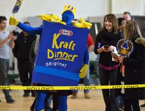 Employees of Automata Solutions cheer on as a 2500 boxes of Kraft dinner fall in a domino arrangement on Thursday April 13, 2017. The company collected 8,000 boxes to donate to the London Food Bank spring food drive. (MORRIS LAMONT, The London Free Press)
