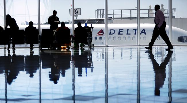 In this Thursday, Oct. 13, 2016, file photo, a Delta Air Lines jet sits at a gate at Hartsfield-Jackson Atlanta International Airport, in Atlanta. Delta is giving airport employees permission to offer passengers up to almost $10,000 in compensation to give up their seats on overbooked flights. Delta's move comes as United Airlines struggles to recover from images of a passenger's forced removal from a sold-out flight. (AP Photo/David Goldman, File)