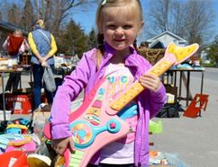 Terry Vollum/For The Intelligencer Five-year-old Octavia O'Connor was all smiles last spring at Stirling Rotary's Giant Yard Sale – thrilled with her purchase of a colorful guitar that matched perfectly with her outfit. This year's sale gets underway at 8 a.m. on Saturday, May 6 at the Goodkey Service Centre in Stirling.