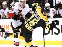 David Krejci #46 of the Boston Bruins is checked by Mark Borowiecki #74 of the Ottawa Senators during the first period at TD Garden on April 6, 2017 in Boston, Massachusetts. (Photo by Maddie Meyer/Getty Images)